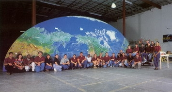 Super Vision employees in front of one half of the world's largest fiber optic display